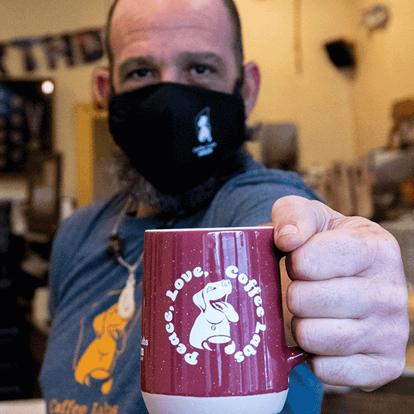 Mike holding coffee labs mug wearing mask